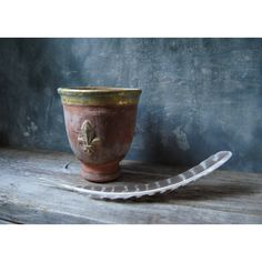 Vintage Fleur de Lis Embossed Clay Pot Terracotta Whitewashed with... (32 CAD) ❤ liked on Polyvore featuring home and home decor