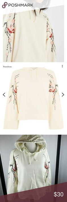 Topshop embroidered hoodie This beautiful hoodie is in amazing condition. There are no tears snags or stains .  While this is a petite size  my mannequin is a size medium and I firmly believe that this would fit a standard size small.  Add a girlie touch to your boyish basics. This oversized hoodie comes in a cream base with pretty floral detail to the arms. With bell-style sleeves. 100% Cotton. Machine wash.  Colour: CREAM Product Code: 04H02LCRM Topshop Tops Sweatshirts & Hoodies