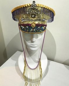 White and Gold captain style military peaked cap with purple beaded fringe and a…