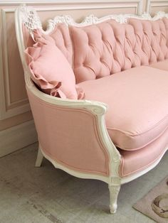 Pink tufted couch