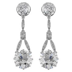 6.37 Carat Edwardian Old European Diamond Drop Earrings. Platinum Edwardian drop earrings consisting of 1 old european cut diamond weighing 3.18 carats and 1 old european cut diamond weighing 3.19 carats, for a total weight of 6.37 carats the stones drop from 2 old european cut diamonds having a total weight of approximately 1.20 carats total weight, set with an additional .35 carats of old european cut diamonds.