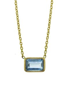 Lori McLean Jewelry - Blue Topaz Rectangle Necklace    Handcrafted in 14-karat yellow gold.  Detailed in topaz.  Pendant measures 1/4-in. across.  Necklace adjusts 16-in. to 18-in. long with lobster clasp.