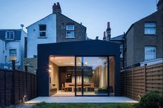 Browse images of Industrial Garden designs: Rear elevation at dusk. Find the best photos for ideas & inspiration to create your perfect home. Sustainable Architecture, Interior Architecture, Interior Design Basics, Single Storey Extension, Rear Extension, Outdoor Doors, Cheap Houses, My Ideal Home, Minimal Home