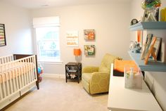 pale neutral wall color, orange and blue accents