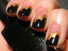 Black and gold diagonal, scalloped tips. A french beige, cream, light coral or muted pink coat under the gold would give this manicure a more polished look rather than the naked nail pictured.