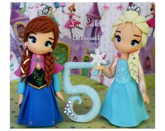 Topo de bolo Anna e Elsa Frozen  Com aproximadamente 12 cm de altura  Obs: O pavio acompanha o produto