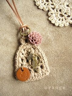 small crochet snippet with embellishments for a necklace pendant