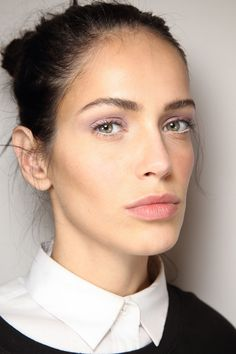 Soft lilac eyes + messy bun at Diane von Furstenberg | Fall 2014 Ready-to-Wear Collection | Style.com