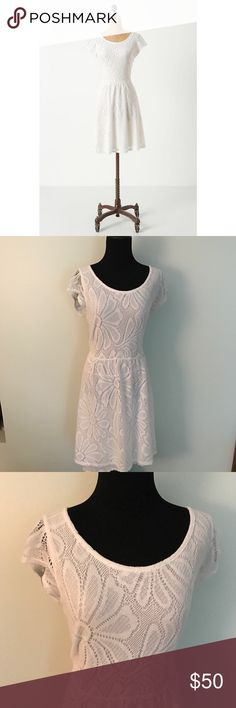{Anthropologie} Deletta Fluttering Flora Dress This beautiful Lace dress is the Fluttering Flora dress from Deletta, sold at Anthropologie. Gorgeous white lace with daisy Floral designs on it. Has functional side zipper. Dress has attached white slip underneath. Size large.   MEASUREMENTS & MATERIAL:  Bust: 16.5 inches across  Sleeve length: 4 inches  Dress length: 35 inches  Waist: 16 inches  70% cotton, 30% polyester Feel free to ask for a specific measurement! Anthropologie Dresses