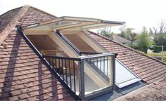 "Invest in your home. Here's a loft conversion with extra ""wow"". These roof windows sit flat on the roof but with a gentle push open up to be come a great feature to enjoy. Via theloftexperts.com"
