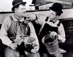 Laurel and Hardy.  omg, I still remember this scene and it has been decades since I've seen it!
