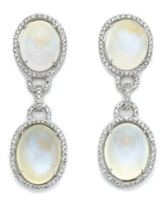 Pair of Moonstone and Diamond Pendant-Earrings   18 kt. white gold, topped by 2 oval cabochon moonstones approximately 14.8 x 11.6 mm., joined by delicate diamond-set circle links, suspending 2 oval cabochon moonstones approximately 17.4 x 12.8 mm., the moonstones framed by small round diamonds, totaling 208 diamonds approximately 1.95 cts., approximately 16 dwt.