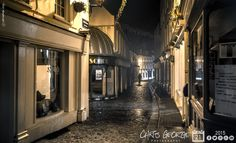 Heading up the Old Quarter. It's damp but quite mild, a whiff of garlic or maybe it's curry in the air, a dog barking in the distance & strains of the Beatles 'Day In The Life' coming from a flat above somewhere. Soaking up the atmosphere like a sponge, only hope my picture does it justice! #Guernsey #GreatThings  Link to the whole collection of 'Georgie's Pic Of The Day' :-http://chrisgeorge.dphoto.com/#/album/4daaes  Picture Ref: 21_10_15 — in St. Peter Port, Guernsey, Channel Islands.