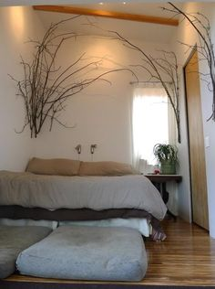 I really like the branches on the wall - what a great way to forest up your space.