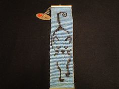 Handmade Bracelet, Cat, Loom Beaded by HappyOtterBeading on Etsy Cat Jewelry, Bead Jewellery, Beaded Jewelry, Bead Loom Patterns, Weaving Patterns, Loom Animals, Native Beadwork, Bead Loom Bracelets, Cat Pattern