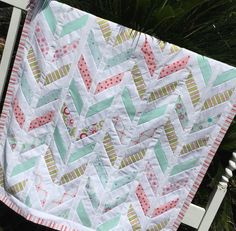 Riley Blake fabrics in a modern Chevron (Herringbone) design. Luxuriously soft Dimple-Dot Minky Fleece on the back provides incredible softness and wonderful texture for baby and Mom.    This is a gorgeous baby quilt! Using the modern chevron or herringbone design, I created this one-of-a-kind quilt to be used everyday. The fabrics are high quality quilting fabrics in beautiful fabric colors with turquoise, yellow, pink, green, and white. Luxuriously soft Minky dimple-dot fleece (Pink) on…