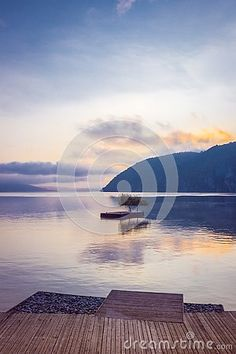 Photo about Beautiful portait shot of the sunrise from the Danube river in Orsova, Romania. Image of water, juicy, september - 127146642 Danube River, Romania, Places To Go, Sunrise, Shots, Stock Photos, Water, Image, Beautiful