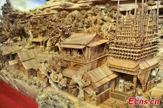A wooden sculpture, featuring the famous painting Along the River During the Qingming Festival, succeeds in creating a new Guinness World Re...