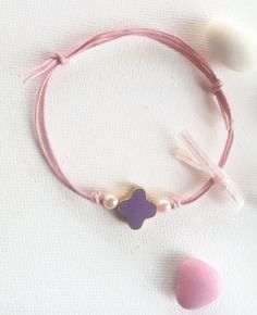 Pink bracelet with a purple enamel cross and pink pearls