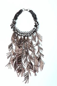 Crystal rhinestone necklace with gunmetal bugle bead feathered fringe cascade and multi chain closure...