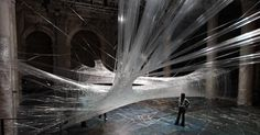 Packing Tape Spiderweb: This installation, by design firm numen / for use, used 530 rolls of tape measuring 117,000 feet and weighing 100 pounds.