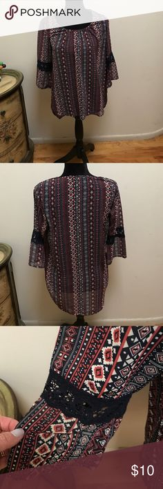 Rue 21 boho top Rue 21 boho top, excellent condition, worn once. Longer in the back and shorter in the front. MEASUREMENTS:  see last pic for front and back lengths.  Armpit to armpit:  18-18 1/2 inches. Sleeve length from shoulder:  17 inches.  Beautiful top Rue 21 Tops Tunics