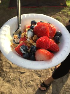 Fresh yogurt parfaits for breakfast while camping.  We used the Stick and the Ball granola and topped with fresh berries and honey.
