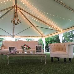 If your going to have a beautiful outdoor tent, creating a lounge area is a must! This classic #weddingdecor creates beautiful ambiance for any outside wedding!  #charlottewedding #queencityweddings #weddingseason2016