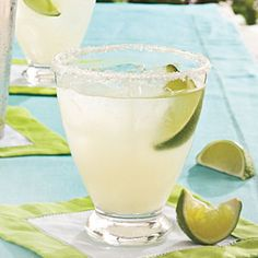Classic Margaritas on the Rocks—These are potent, yet amazingly smooth-tasting when you use good-quality tequila and orange liqueur and thoroughly shake the mixture with ice before pouring over ice cubes to serve. | SouthernLiving.com