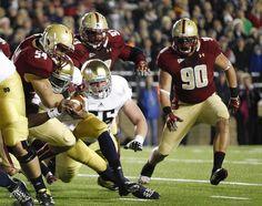 Irish quarterback Everett Golson (with ball) scores a touchdown against Boston College during the first half.