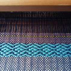 Now that the rug is done, the other loom is out. I warped it a few weeks ago to make some cushion covers. Using 8 shafts for the first time. It's always fascinating to watch the patterns emerge. #weaving #writtenincloth #handwoventextiles
