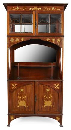 SHAPLAND & PETTER, BARNSTAPLE, attribution, ART NOUVEAU MAHOGANY AND MARQUETRY INLAID CABINET, CIRCA 1900, the projecting cornice above a frieze, marquetry inlaid in brass and copper with a frieze of stylised flower heads, above astragal glazed doors and side panels with open shelf below and with mirror back, the whole raised on a base with twin doors on bracket feet  91cm wide, 175.5cm high, 41cm deep  |  Sold for £625 April 18, 2012