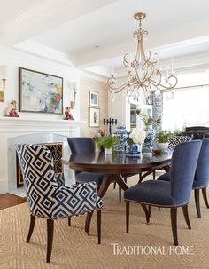 More to love.  Blue and white DR with chinoiserie and patterned head chairs, grass cloth walls, crystal chandelier, sisal rug...