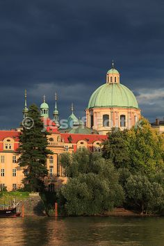 Monastery of the Knights of the Cross with a Red Star and Dome of the Church of Saint Francis Seraph on the Aleš Embankment, Prague, Czech Republic