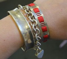 Make a quick and adjustable size bracelet with a hose clamp and ribbon.