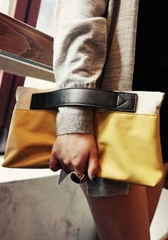love this yellow contrast folded clutch http://rstyle.me/n/wkzvdr9te