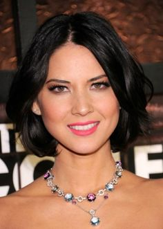10. Olivia Munn Hairstyle for round faces: Cute chin-length bob  American actress and comedienne Olivia Munn looks stunning with her cute, chin-length bob. She sports a shallow middle-parting and short, choppy layers of hair that make her round face look longer and slimmer. Before you get your hair cut short, consult with your stylist to find the perfect style for your round face.