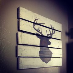 Ooooh, I've seen this deer silhouette a thousand times but I LOVE it on pallett wood like this! This is from Etsy but looks easy enough for a DIY project. Deer Head Silhouette Pallet Board Sign Wooden Rustic Pallet Art on Etsy, $55.00
