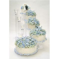 A gorgeous crystal clear cake stand set that cascades down each cake tier  in the fashion of a stairway. Individual tiers allow you to create a flow  of decorations from one cake to the next or create your own configuration  to suit your personal style. Strong and sturdy to hold the heaviest of