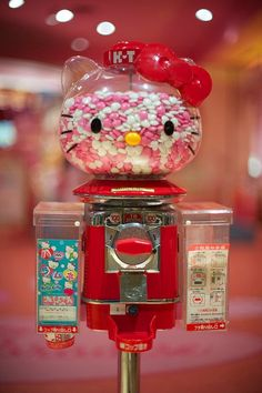 Hello Kitty candy/gum machine omg! They're killing me with all this hello kitty stuff I can't have! xD