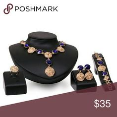 "BRAND NEW FASHION 4 PC NECKLACE SET BRAND NEW FASHION 4 PC NECKLACE SET IN GOLDTONE & SAPPHIRE BLUE CRYSTAL, LEAD FREE, 18""L NECKLACE, 7"" BRACELET, ADJUSTABLE RING, LEVER BACK PIERCED EARRINGS. Jewelry Necklaces"