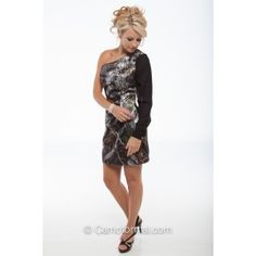Cold shoulder fitted camo dress with long sleeve. Shown in Mossy Oak New Breakup and Black Sleeve. Available in all camo patterns and White or Black Sleeve in sizes 2-30. Made in the USA.