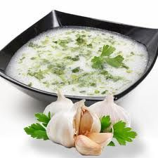 Ingredients # 1 head garlic (peeled and separated into cloves) # 1 teaspoon salt # 2 tablespoons vegetable oil # cup sour cream (re. Eastern European Recipes, European Cuisine, Romanian Desserts, Romanian Recipes, Serbian Recipes, Romania Food, Good Food, Yummy Food, Exotic Food