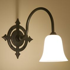 'Gunthwaite' wrought iron wall light in natural black with clear frosted bell shade
