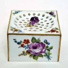 Sand Box, c.1790  Hard paste porcelain, coloured enamels and gilt  German, Meissen  Marks: crossed swords and the star of the Marcolini period  Width: 6.8 cm.  This is part of a set including an inkstand