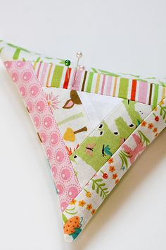 Triangular Log Cabin Pincushion Tutorial by Jeni Baker, via Flickr