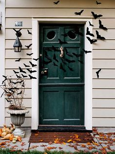 Felt bats - inexpensive and easy decor for the entry door. The arrangement of these makes it particularly realistic looking.