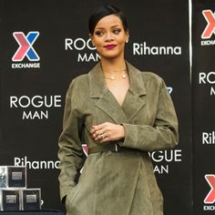 November 13, 2014 Rihanna looks rather beguiling in this classic trench coat done up in ultra luxe suede....she could be the new Bond Girl!