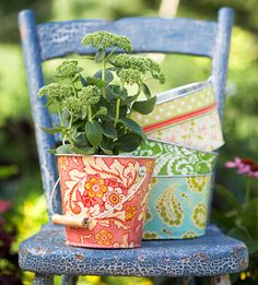 Colorful fabric + decoupage = pretty flowerpots  ....  Make it a garden party - Invite fellow gardeners over to make the pots together, swap gardening advice, even swap flowers.  After all, flowers are made for sharing!