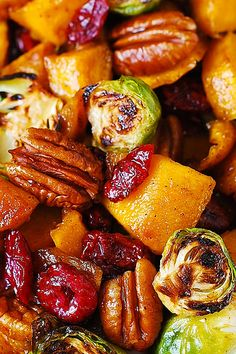 Roasted brussel sprouts, cinnamon butternut squash, pecans and cranberries.  This looks like the most healthy and beautiful holiday side dish!